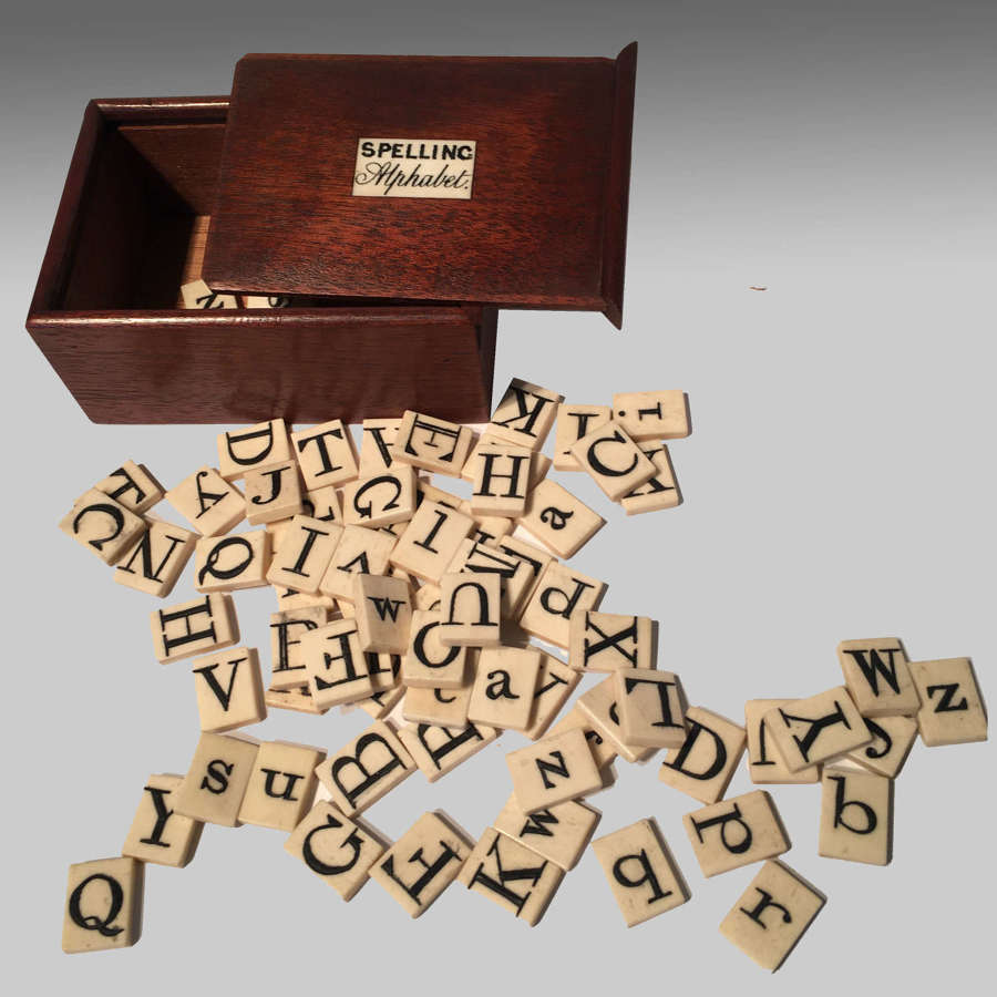 Boxed bone spelling alphabet