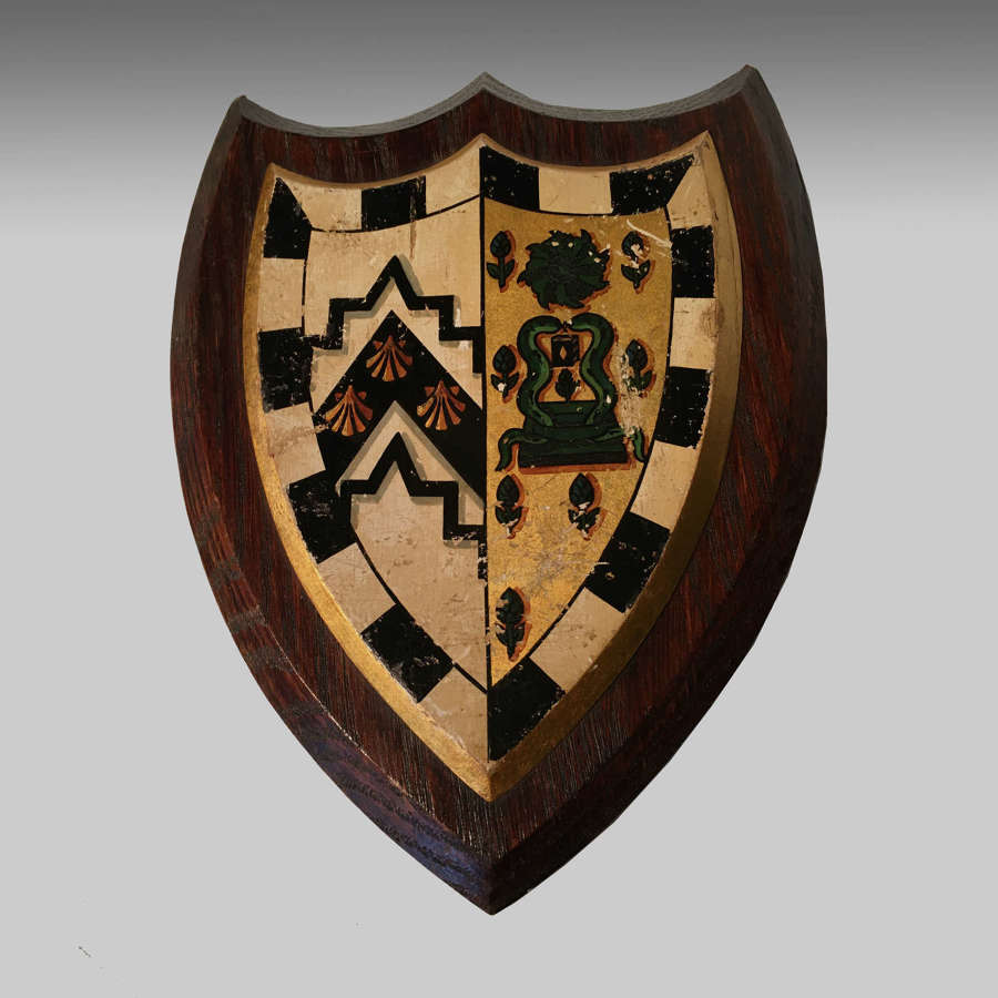 Armorial oak shield - the arms for Gonville & Caius College, Cambridge