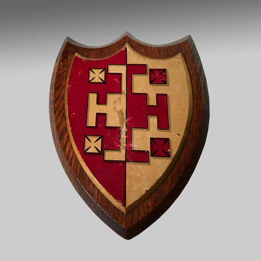 Armorial oak shield, the arms of Selwyn College, Cambridge
