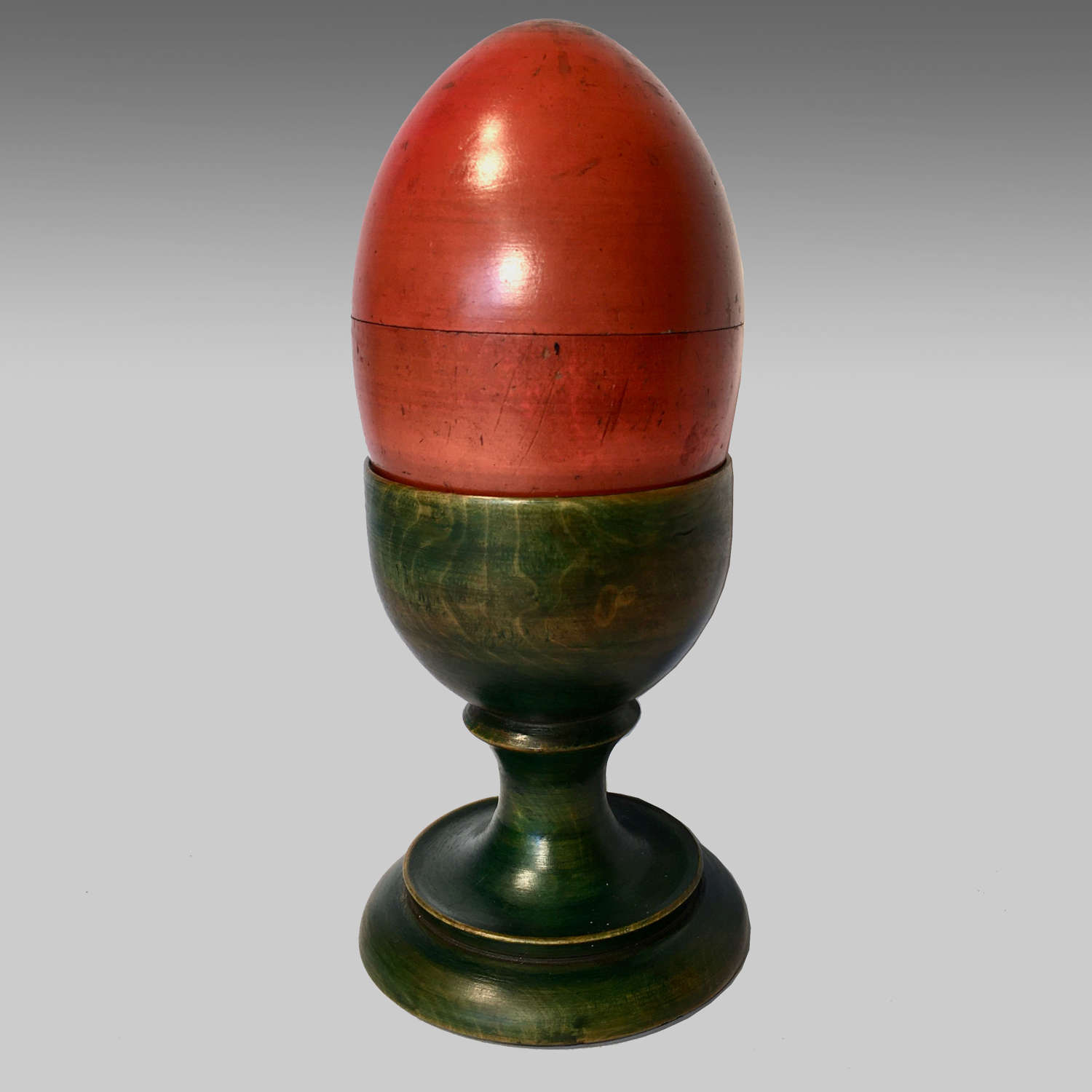 19th century painted treen nesting eggs and eggcup