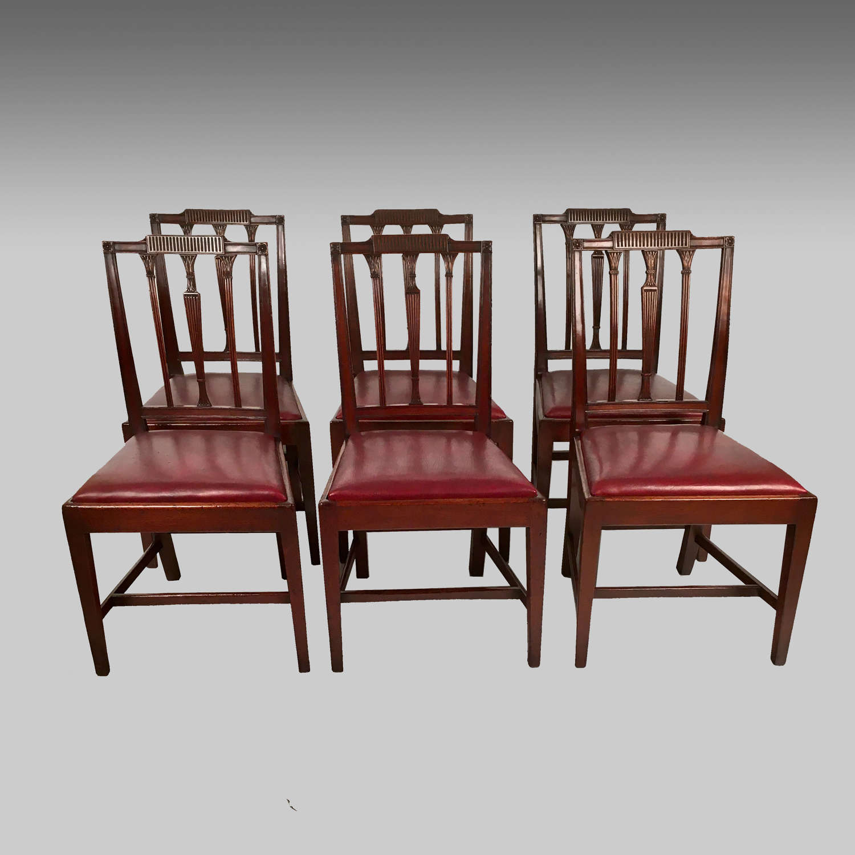 Eight 18th century Sheraton mahogany dining chairs
